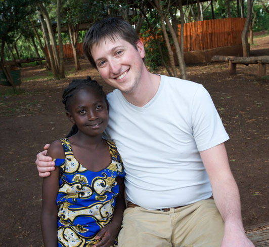 Brad Ruggles with Compassion sponsored child