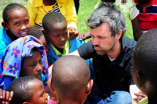 Shaun Groves joking with Kenyan Compassion International children