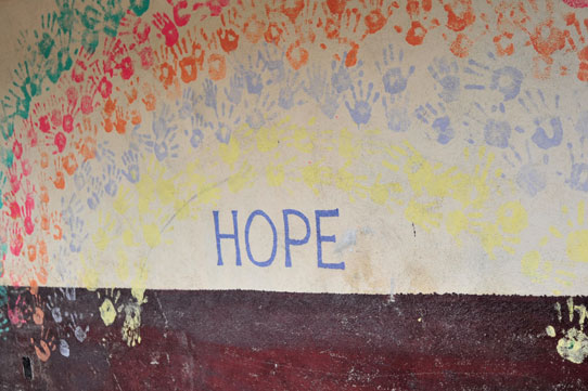 Word Hope painted on a wall