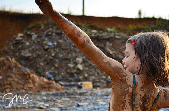 Muddy kid dancing