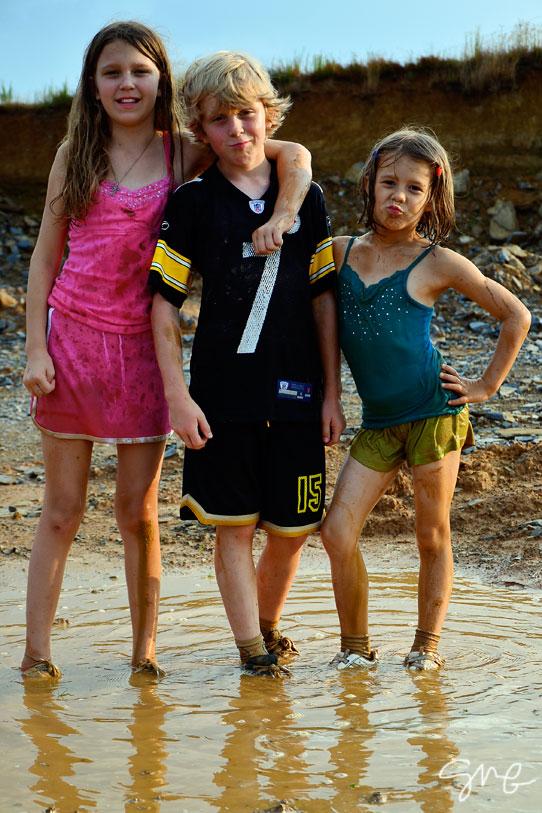 Three muddy kids