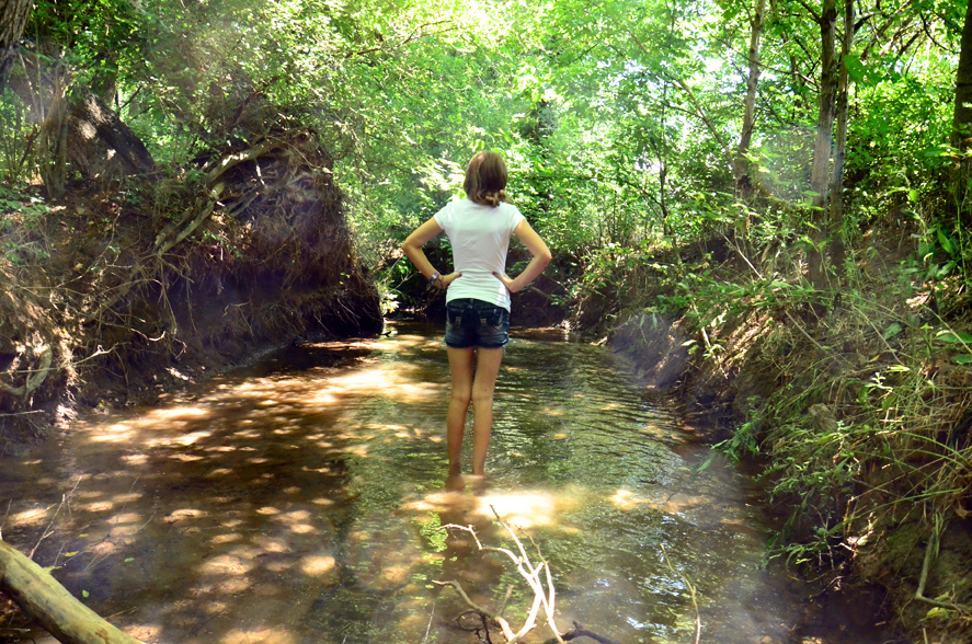 Gabriella Standing In The Creek