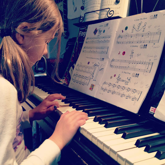 Penelope-playing-piano