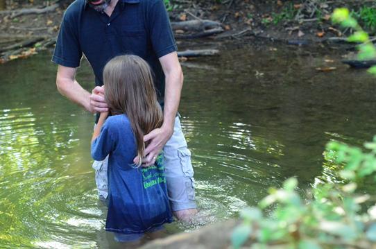 Shaun-Groves-baptizing-daughter-Penelope-2