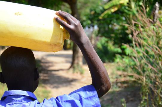 Girl-walking-with-water-jug-on-head