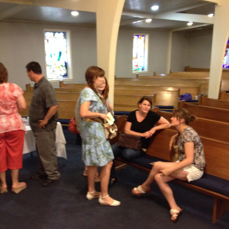 Women-talking-in-church-small