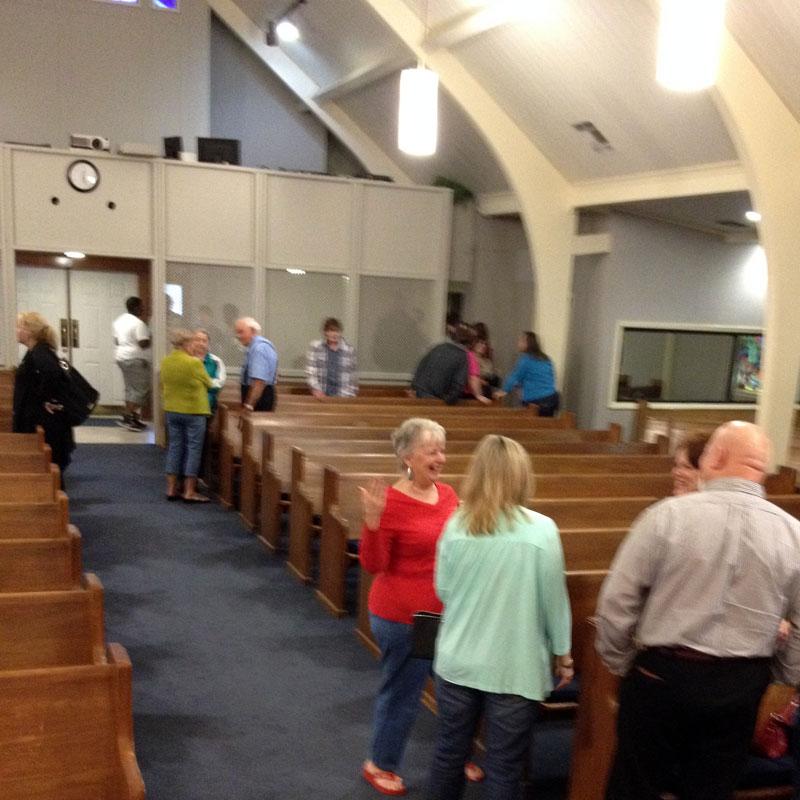 people-talking-in-church