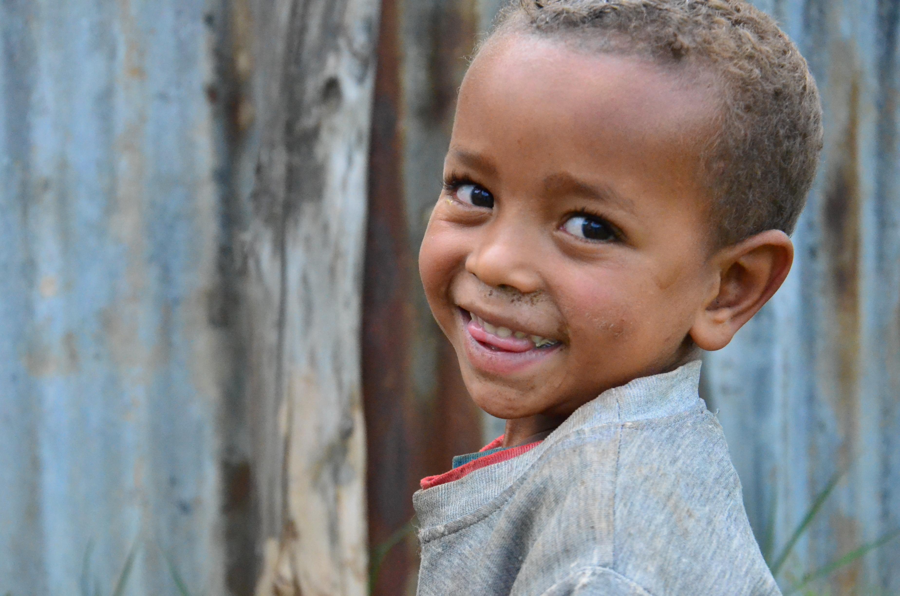 Ethiopian boy malnutrition smiling