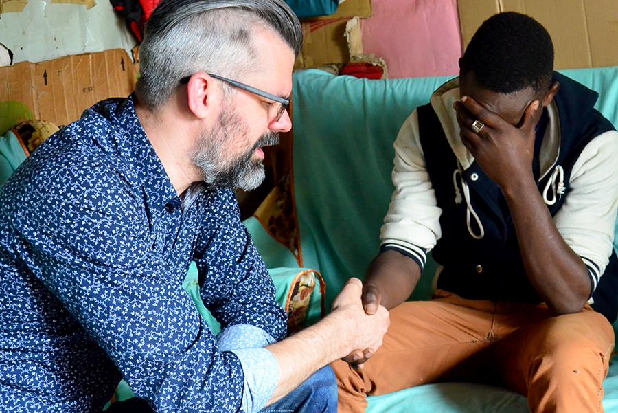 Shaun praying in Kenya