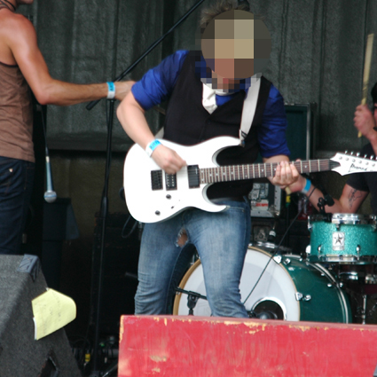 screamo guitar player in torn jeans
